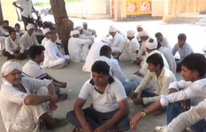 Garmadi villagers wait outside the health centre for the body of slain RTI activist